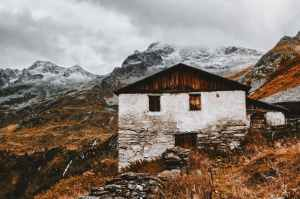 white and brown house near snow capped mountains